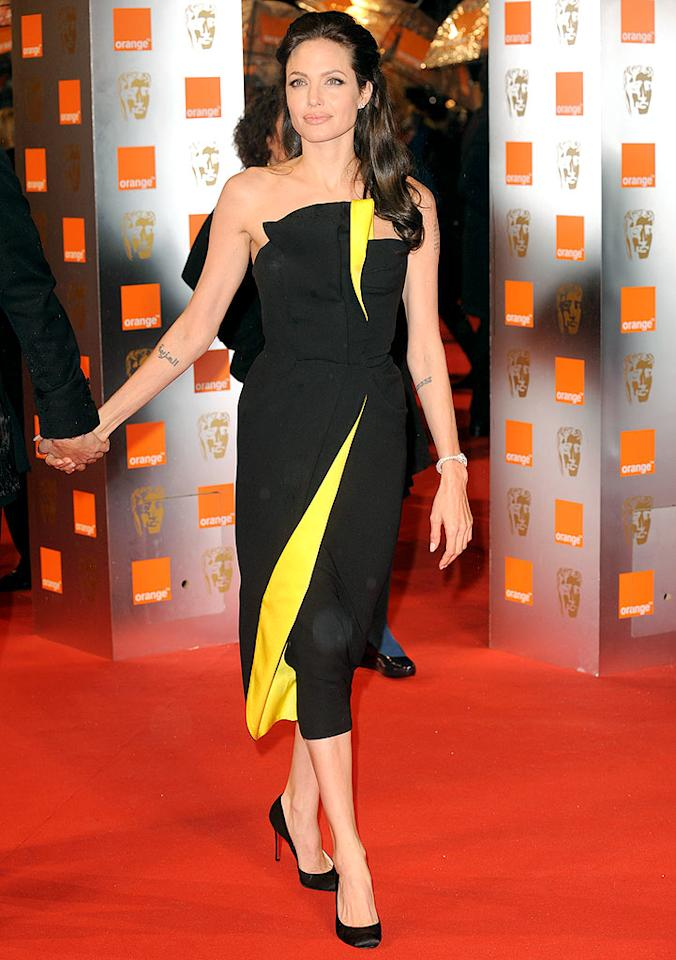 "Angelina Jolie looked absolutely amazing in a bold black-and-yellow Armani Prive masterpiece at the BAFTAs. <a href=""http://www.splashnewsonline.com"" target=""new"">Splash News</a> - February 8, 2009"