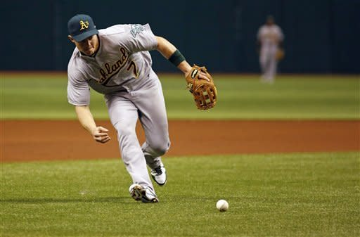 Oakland Athletics Adam Rosales runs to field a ball hit by Tampa Bay Rays Carlos Pena during a baseball game, Saturday, May 5, 2012, in St. Petersburg, Fla. (AP Photo/Scott Iskowitz)