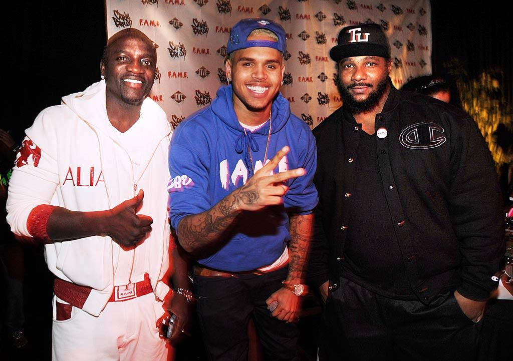 """Chris Brown (with Akon and Polow da Don) was all smiles in Atlanta, Georgia, while hosting a secret listening session for fans to promote the upcoming release of his fourth album, <i>F.A.M.E.</i>, which drops on March 22. Rick Diamond/<a href=""""http://www.wireimage.com"""" target=""""new"""">WireImage.com</a> - March 15, 2011"""