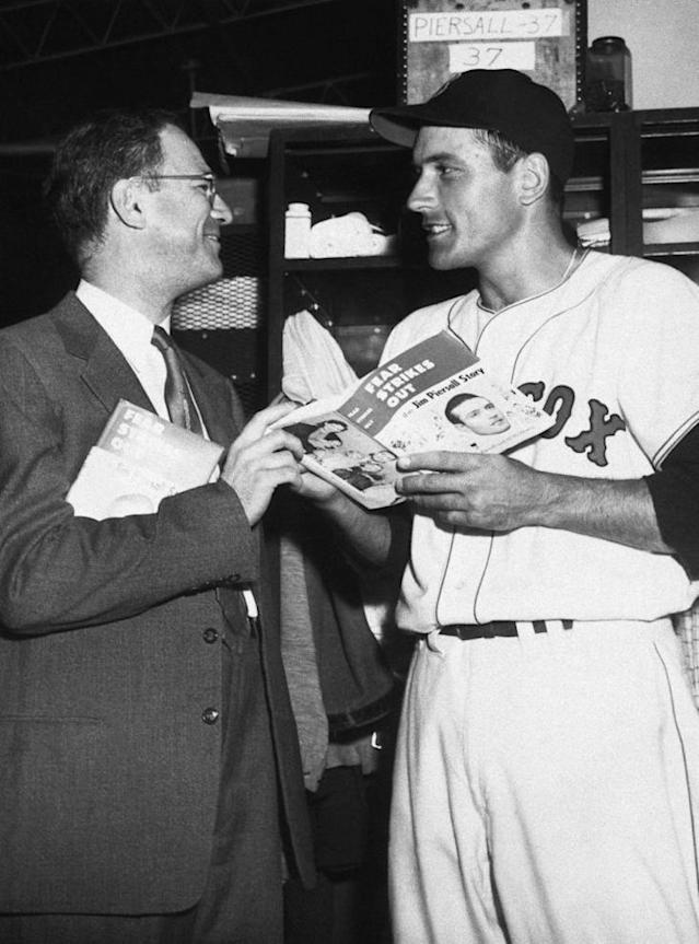"Jim Piersall holds a copy of his new book ""Fear Strikes Out,"" with co-author Al Hirschberg, on May 6, 1955. The story tells of Piersall's mental breakdown in 1952 and his fight back to normalcy. (AP Photo)"