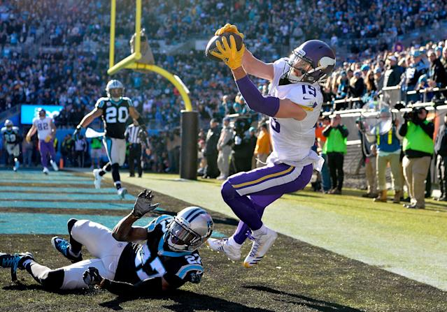 <p>Adam Thielen #19 of the Minnesota Vikings attempts a pass catch against Kevon Seymour #27 of the Carolina Panthers in the second quarter during their game at Bank of America Stadium on December 10, 2017 in Charlotte, North Carolina. (Photo by Grant Halverson/Getty Images) </p>