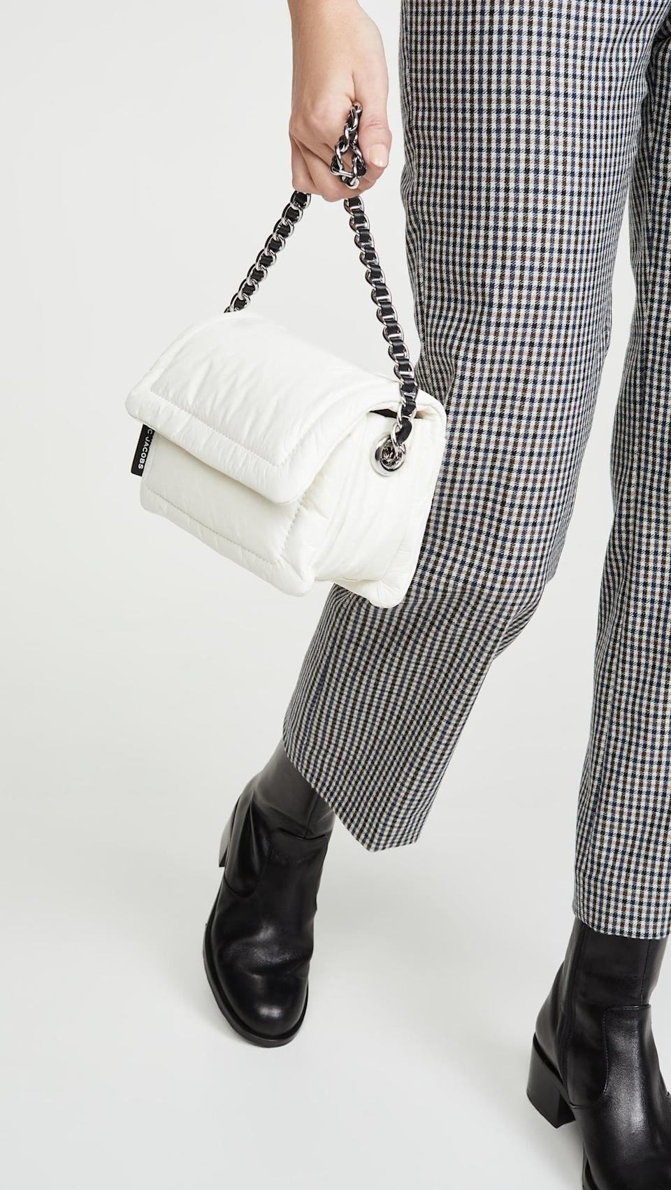 "<p>This cute <a href=""https://www.popsugar.com/buy/Marc-Jacobs-Mini-Pillow-Bag-532938?p_name=The%20Marc%20Jacobs%20Mini%20Pillow%20Bag&retailer=shopbop.com&pid=532938&price=450&evar1=fab%3Aus&evar9=36291197&evar98=https%3A%2F%2Fwww.popsugar.com%2Ffashion%2Fphoto-gallery%2F36291197%2Fimage%2F47027884%2FMarc-Jacobs-Mini-Pillow-Bag&list1=shopping%2Choliday%2Cwinter%2Cgift%20guide%2Cwinter%20fashion%2Choliday%20fashion%2Cfashion%20gifts&prop13=api&pdata=1"" rel=""nofollow noopener"" class=""link rapid-noclick-resp"" target=""_blank"" data-ylk=""slk:The Marc Jacobs Mini Pillow Bag"">The Marc Jacobs Mini Pillow Bag</a> ($450) is at the top of our wish list.</p>"