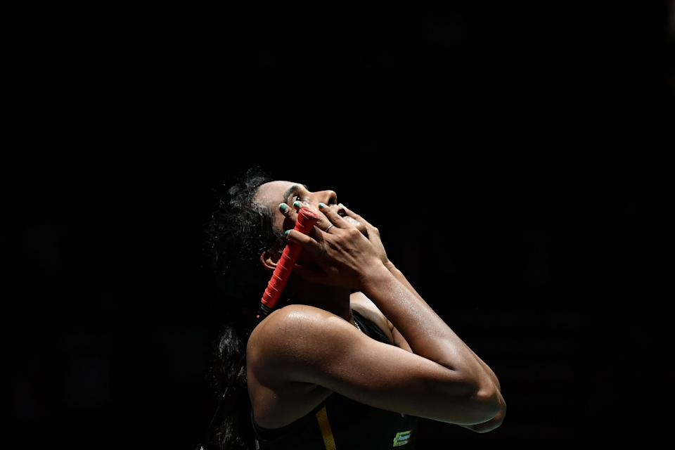 India's Pusarla Venkata Sindhu celebrates after winning against Japan's Nozomi Okuhara during their women's singles final match at the BWF Badminton World Championships at the St Jakobshalle in Basel on August 25, 2019. (Photo by FABRICE COFFRINI / AFP)        (Photo credit should read FABRICE COFFRINI/AFP/Getty Images)