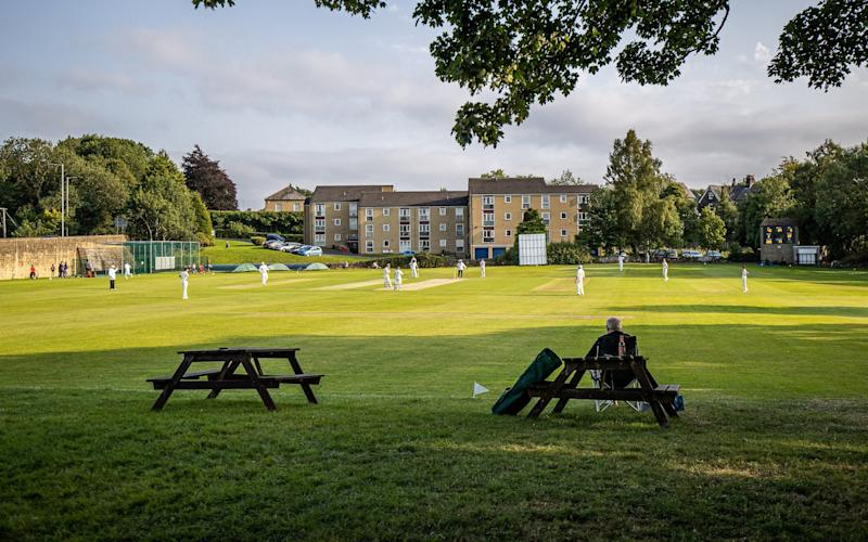 Cricketers playing a match at Menston Cricket Club - Charlotte Graham
