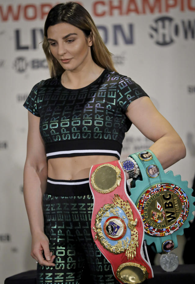 FILE - In this Feb. 26, 2019, file photo, Christina Hammer, from Germany, hold her title belts during a news conference Tuesday Feb. 26, 2019, in New York. Hammer faces Claressa Shields on April 13 in Atlanta City, N.J., for the undisputed middleweight boxing championship. (AP Photo/Bebeto Matthews, File)