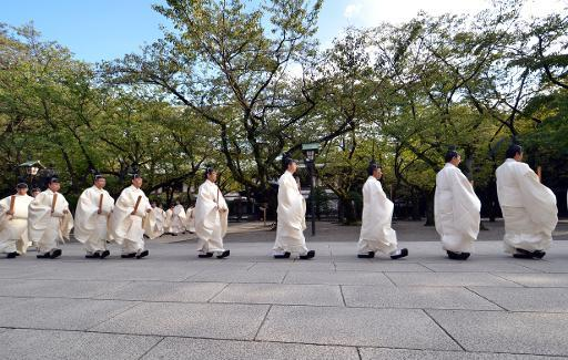 "<p>Shinto priests walk to the main shrine as they administer a Shinto rite ""Kiyoharai"" on the first day of the four-day autumn festival at the Yasukuni shrine in Tokyo on October 17, 2013</p>"
