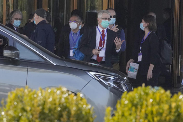 Members of the World Health Organization team of researchers prepare to leave on a field trip in Wuhan in central China's Hubei province on Friday, Jan. 29, 2021. The World Health Organization team of researchers emerged from their hotel Thursday for the first time since their arrival in the central Chinese city of Wuhan to start searching for clues into the origins of the COVID-19 pandemic. (AP Photo/Ng Han Guan)