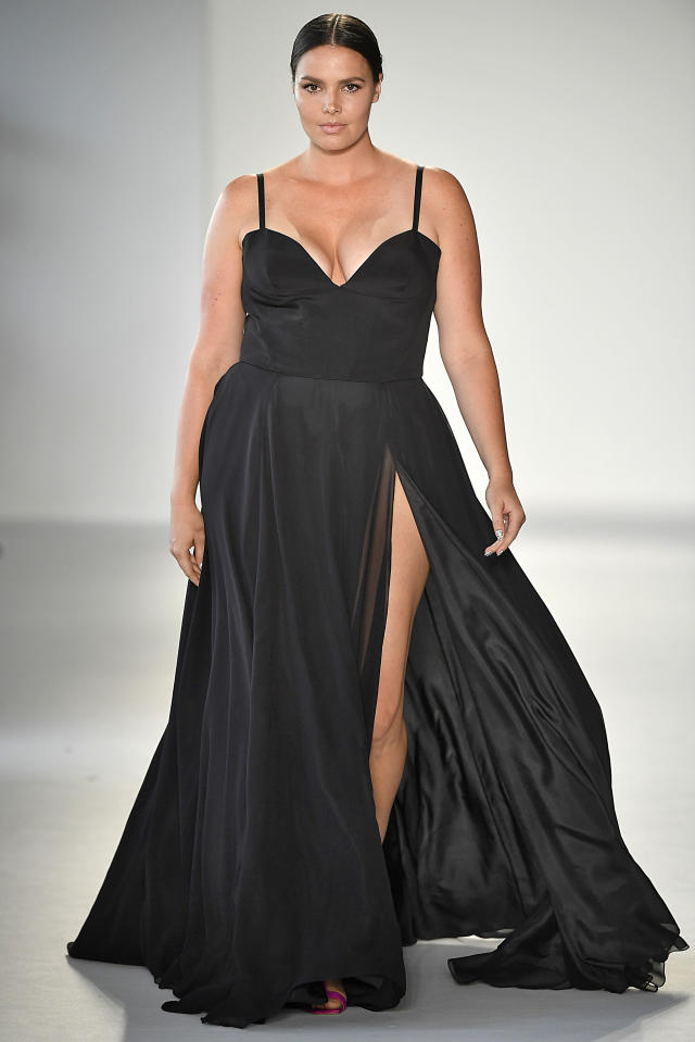 Candice Huffine wears a high-slit black gown from the SS18 Christian Siriano fashion show in New York, September 2017. (Photo: Getty)