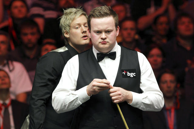 Shaun Murphy of England lines up a shot during a frame against Australia's Neil Robertson during the final of the BGC masters snooker tournament at Alexandra Palace in London on January 22, 2012. AFP PHOTO / JUSTIN TALLIS (Photo credit should read JUSTIN TALLIS/AFP/Getty Images)
