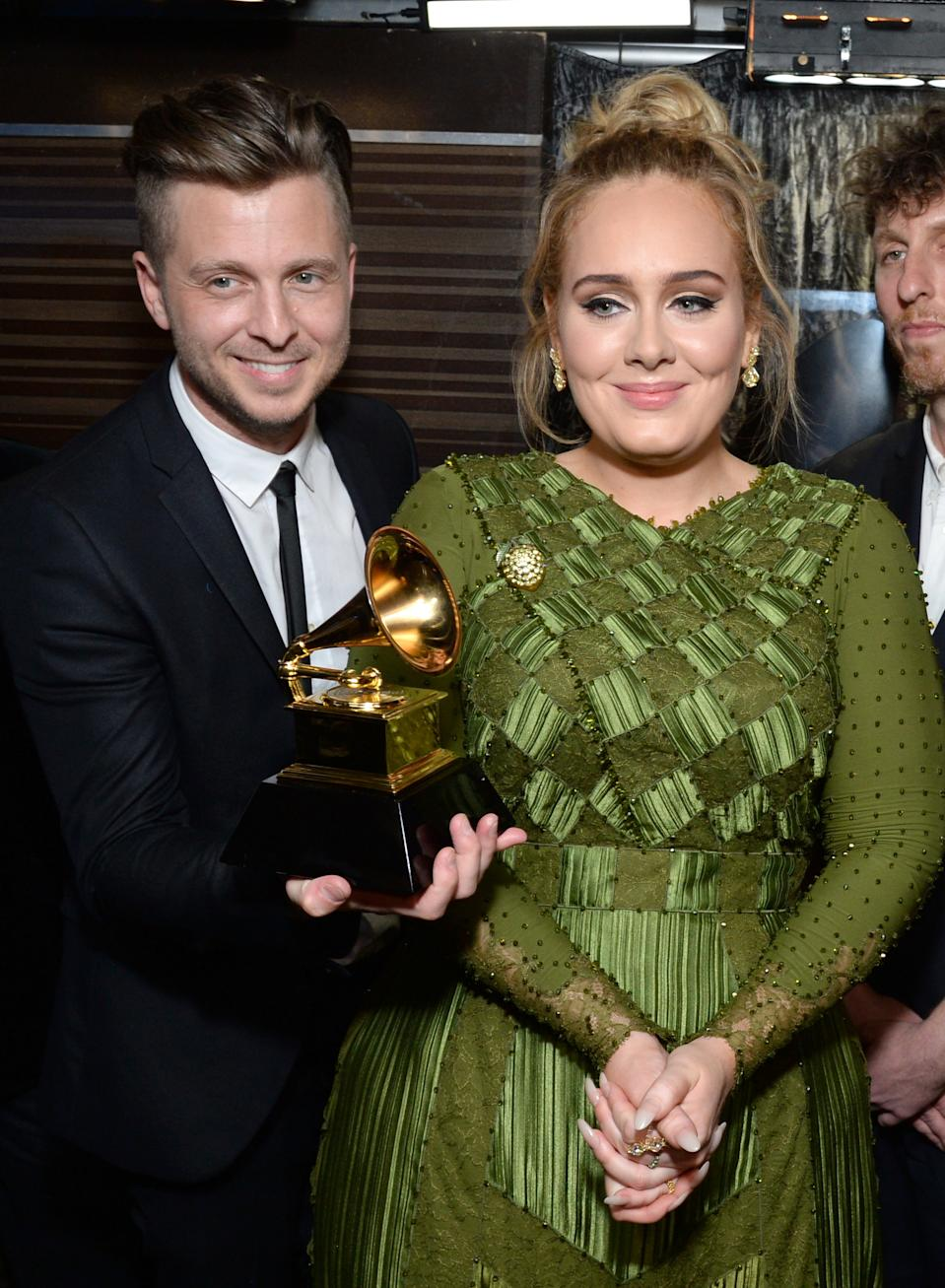 LOS ANGELES, CA - FEBRUARY 12:  Recording artist-producer Ryan Tedder (L) and recording artist Adele, co-recipients of the Album Of The Year award for '25,' pose backstage during the The 59th GRAMMY Awards at STAPLES Center on February 12, 2017 in Los Angeles, California.  (Photo by Michael Kovac/Getty Images for NARAS)