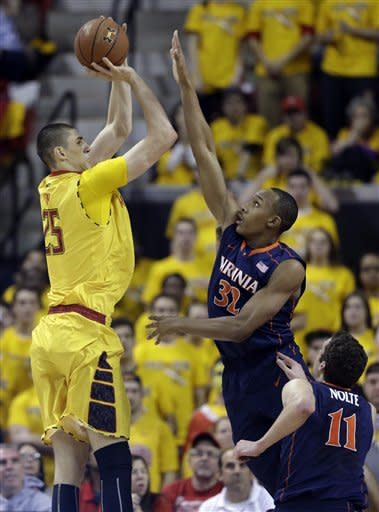 Maryland center Alex Len, left, of Ukraine, shoots over Virginia forwards Darion Atkins (32) and Evan Nolte in the first half of an NCAA college basketball game in College Park, Md., Sunday, Feb. 10, 2013. (AP Photo/Patrick Semansky)