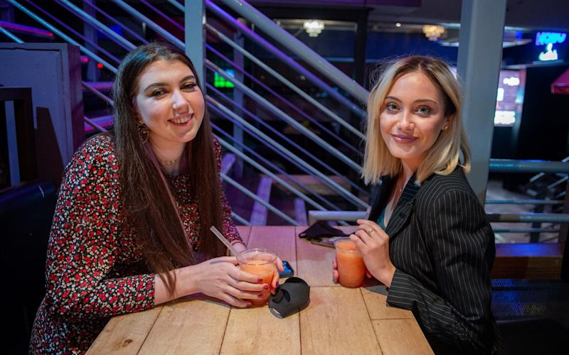Students Hannah Ward, 18, (Glasgow University) (L) and first year University of Glasgow student Jenijo MacFarlane, 18, (R) inside Firewater nightclub/bar on the famous Sauchiehall Street, Glasgow, which was much quieter than usual. September 25, 2020. Firewater usually closes at 3am - James Chapelard