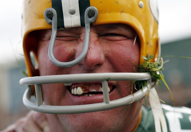Randy Domres dresses up like former Green Bay Packers' Ray Nitschke before an NFL football game against the Detroit Lions Sunday, Oct. 6, 2013, in Green Bay, Wis. (AP Photo/Jeffrey Phelps)