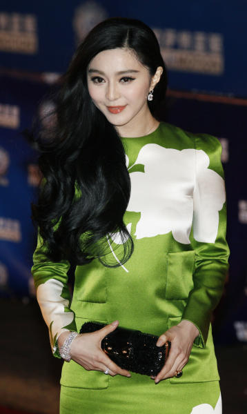 """FILE- In this Wednesday, April 10, 2013 file photo, Chinese actress Fan Bing Bing poses on the red carpet at the Huading Awards in Hong Kong. Fan won best actress for """"Double Exposure."""" She's an A-lister in her native China, but her Hollywood debut in """"Iron Man 3"""" was reportedly cut back. (AP Photo/Kin Cheung, File)"""