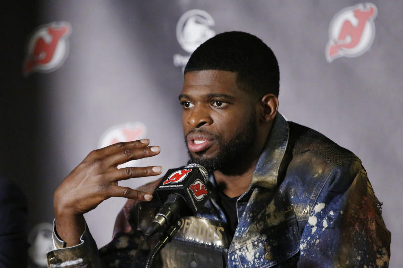 FILE - In this July 25, 2019, file photo, New Jersey Devils' NHL hockey defenseman P.K. Subban speaks after he was introduced to the media at the Prudential Center in Newark, N.J. Subban and the NHL are bringing something new to television Saturday for fans and everyone dealing with the isolation and hardships caused by the coronavirus pandemic. It's NHL Hat Trick Trivia. Subban is the host of the weekly 30-minute show in which contestants will answer up to three hockey trivia questions for prizes,  the top one being two tickets to any game next season. (AP Photo/Kathy Willens, File)