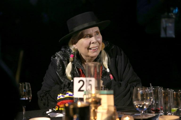 Joni Mitchell, shown here at an awards show in 2020, says she's still working to recover after a 2015 brain aneurysm