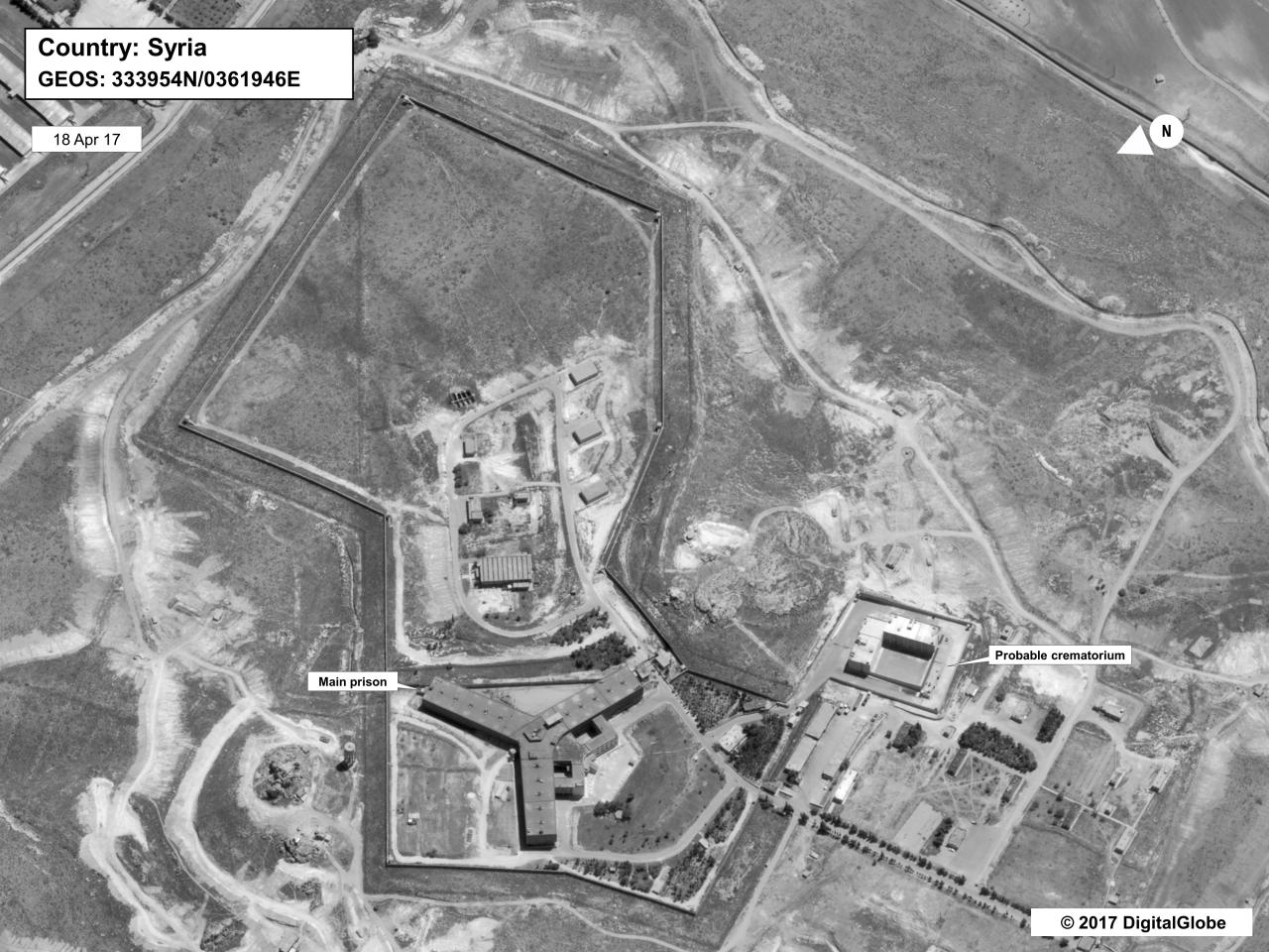 """FILE - This April 18, 2017 file satellite image provided by the State Department and DigitalGlobe, shows what the State Department described as a building in a prison complex in Syria that was modified to support a crematorium. The Syria Justice and Accountability Center, a Washington-based Syrian rights group said in a report, released Tuesday, May 21, 2019, that thousands of documents collected from abandoned Syrian government offices reveal the reach of President Bashar Assad's security agencies, offering a rare glimpse into the inner workings of his secretive apparatus. The documents include handwritten notes from top commanders to """"do what is necessary"""" to quell anti-Assad protests. (State Department/DigitalGlobe via AP, File)"""