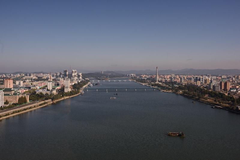 The Pyongyang city skyline shows the landmark Juche tower (centre R) and the Kim Il-Sung stadium (top C) along the Taedong river (AFP Photo/Ed Jones)