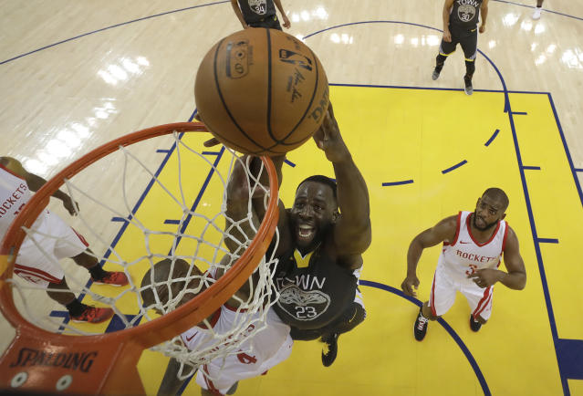 Golden State Warriors forward Draymond Green (23) shoots over Houston Rockets forward P.J. Tucker during the first half in Game 4 of the NBA basketball Western Conference Finals Tuesday, May 22, 2018, in Oakland, Calif. (AP Photo/Marcio Jose Sanchez, Pool)