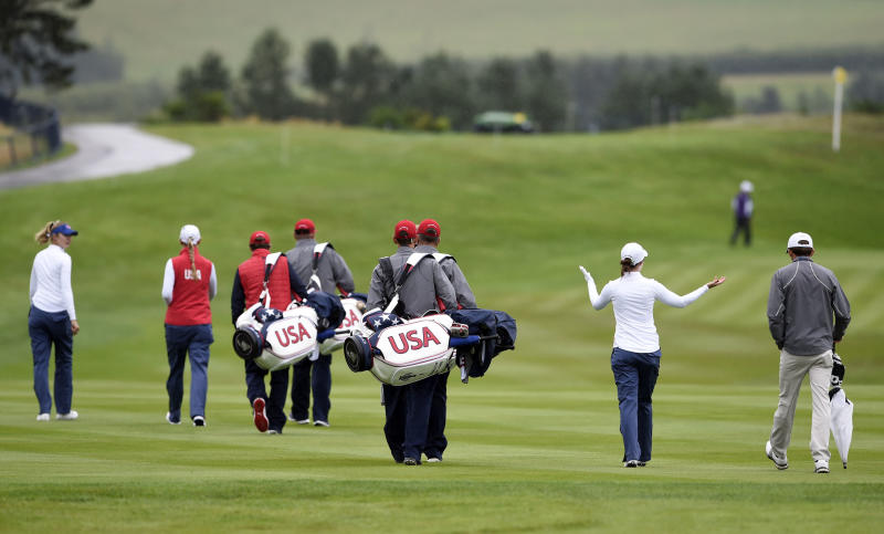 Team USA's Brittany Altomare, second right, gestures as she walks up the 1st fairway during the preview day ahead of the 2019 Solheim Cup at Gleneagles Golf Club, Scotland, Monday Sept. 9, 2019. (Ian Rutherford/PA via AP)