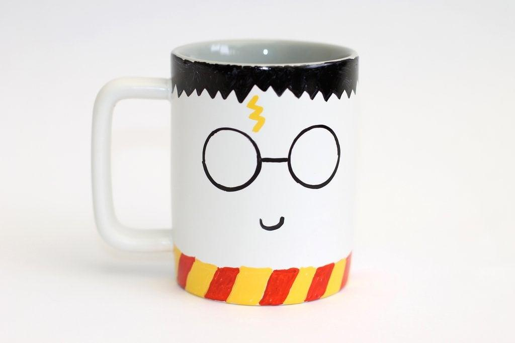 "<p>No magical supplies are needed to put together this easy (and cute!) <a href=""https://www.popsugar.com/smart-living/DIY-Harry-Potter-Mug-40955139"" target=""_blank"" class=""ga-track"" data-ga-category=""Related"" data-ga-label=""http://www.popsugar.com/smart-living/DIY-Harry-Potter-Mug-40955139"" data-ga-action=""In-Line Links"">DIY Harry Potter mug</a>. Simply pull out your permanent markers and turn on your oven to get started. May we suggest adding some Butterbeer to the finished product? </p>"