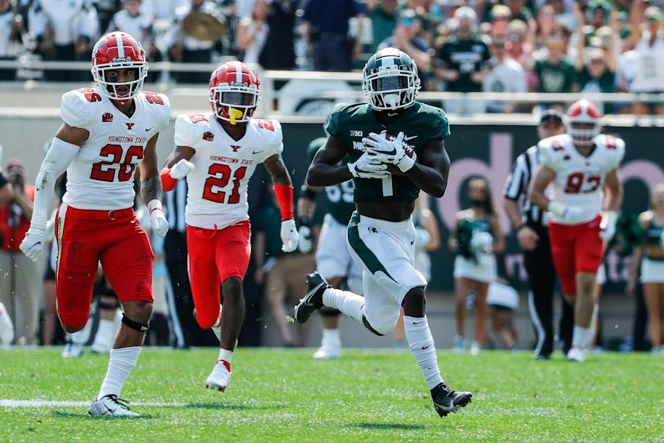 Michigan State wide receiver Jayden Reed (1) makes a catch against Youngstown State during the first half at Spartan Stadium in East Lansing on Saturday, Sept. 11, 2021.