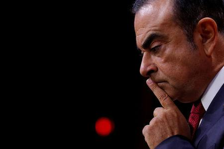 FILE PHOTO: Ghosn, Chairman and CEO of the Renault-Nissan Alliance, reacts during news conference in Paris