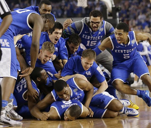 Kentucky players celebrate on the court after their 74-73 victory over Wisconsin in an NCAA Final Four tournament college basketball semifinal game Saturday, April 5, 2014, in Arlington, Texas. (AP Photo/Eric Gay)