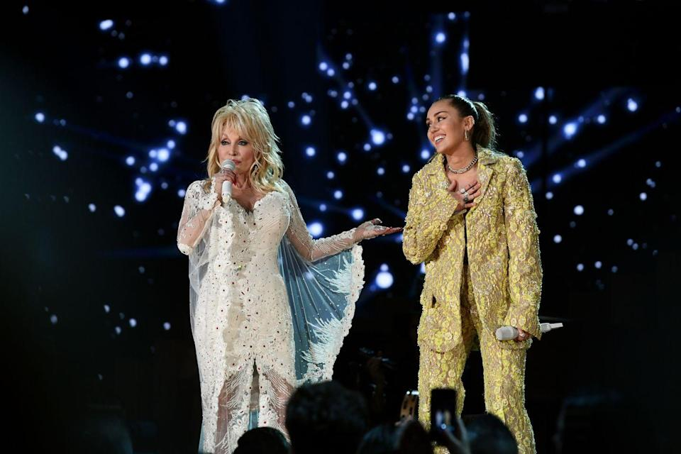 <p>While these two aren't related by blood, Dolly Parton has been BFFs with Billy Ray Cyrus for years. When Miley was born, he made Dolly her godmother. Aw!</p>