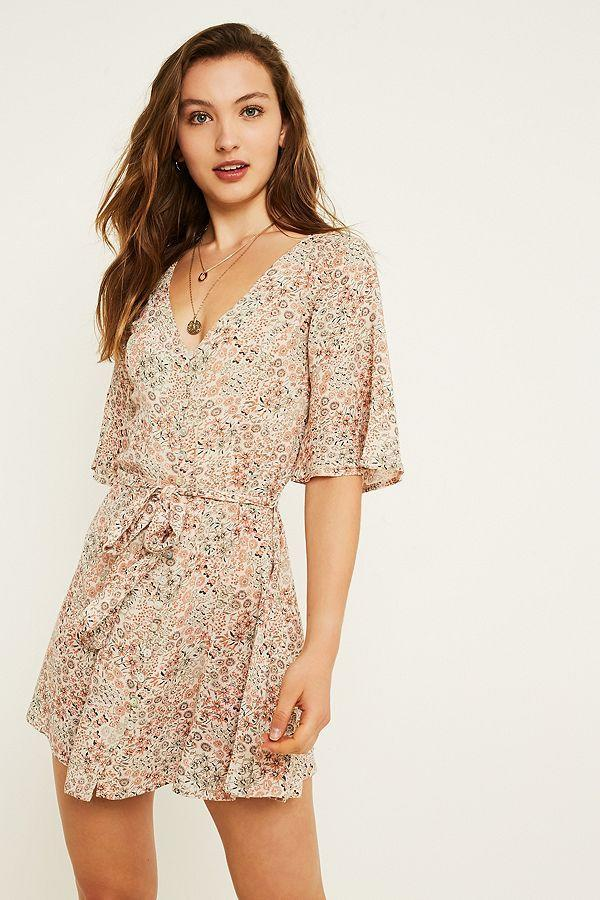 "<p>The print on this dress is the perfectly pretty for the daytime. <br><em><a href=""https://www.urbanoutfitters.com/en-gb/shop/uo-daydream-sage-floral-button-through-dress?category=new-in-womens-clothing&color=012"" rel=""nofollow noopener"" target=""_blank"" data-ylk=""slk:Buy here."" class=""link rapid-noclick-resp"">Buy here. </a></em> </p>"