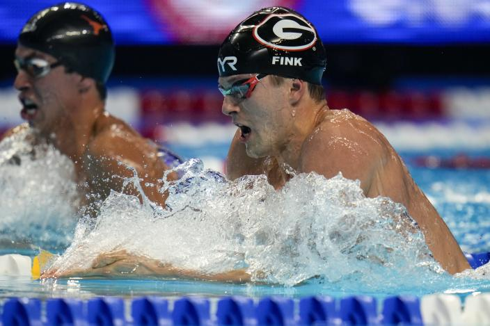 Nic Fink participates in the men's 200 breaststroke during wave 2 of the U.S. Olympic Swim Trials on Thursday, June 17, 2021, in Omaha, Neb. (AP Photo/Jeff Roberson)