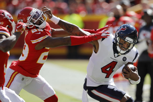 Houston Texans quarterback Deshaun Watson (4) is tackled by Kansas City Chiefs cornerback Kendall Fuller (29) during the first half of an NFL football game in Kansas City, Mo., Sunday, Oct. 13, 2019. (AP Photo/Colin E. Braley)