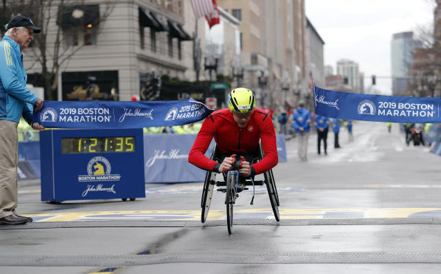 Daniel Romanchuk, of Urbana, Ill., breaks the tape to win the men's handcycle division of the 123rd Boston Marathon on Monday, April 15, 2019, in Boston. (AP Photo/Winslow Townson)