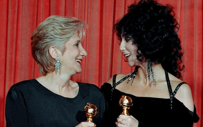 Dukakis with Cher at the Golden Globes in 1988 - AP