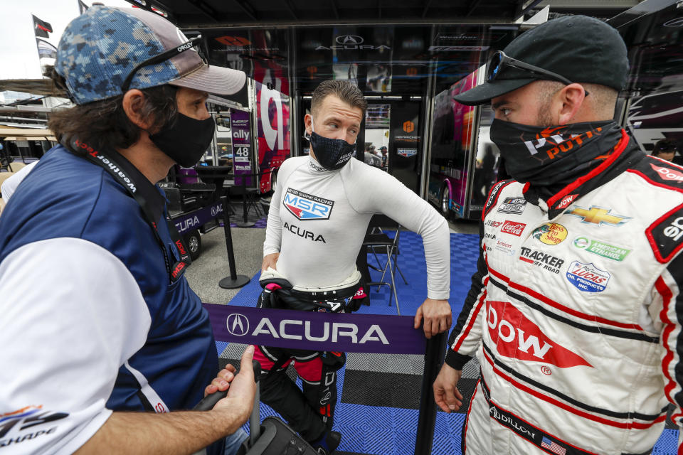 <strong><em>Austin Dillon talked with fellow NASCAR driver AJ Allmendinger while in the Daytona International Speedway garage for the Roar Before the Rolex 24 test session last Saturday (IMSA).</em></strong>