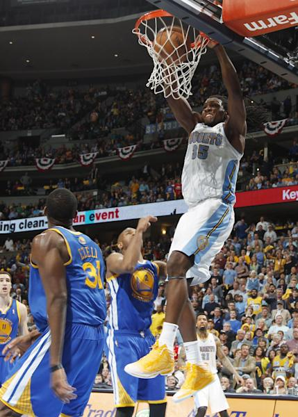Denver Nuggets forward Kenneth Faried, right, dunks over Golden State Warriors center Festus Ezeli, left, of Nigeria, and guard Jarrett Jack in the fourth quarter of Game 5 of their first-round NBA basketball playoff series, Tuesday, April 30, 2013, in Denver. The Nuggets won 107-100. (AP Photo/David Zalubowski)