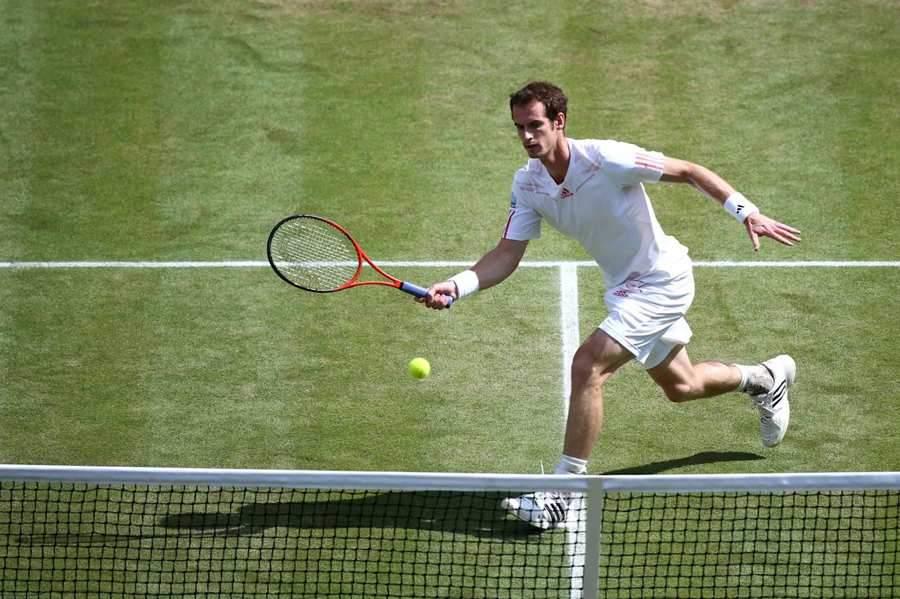 LONDON, ENGLAND - JULY 08:  Andy Murray of Great Britain returns a shot during his Gentlemen's Singles final match against Roger Federer of Switzerland on day thirteen of the Wimbledon Lawn Tennis Championships at the All England Lawn Tennis and Croquet Club on July 8, 2012 in London, England.  (Photo by Paul Gilham/Getty Images)
