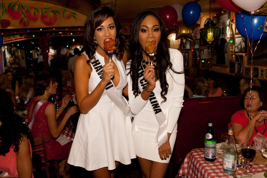 Miss Hawaii USA 2013, Brianna Acosta; and Miss North Carolina USA 2013, Ashley Love-Mills;  enjoy the welcome dinner at Buca di Beppo in Las Vegas, Nevada on Wednesday June 5, 2013.