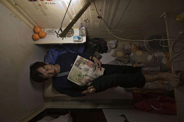 A resident who only gave his surname Yeung, takes a rest. Photo: AP