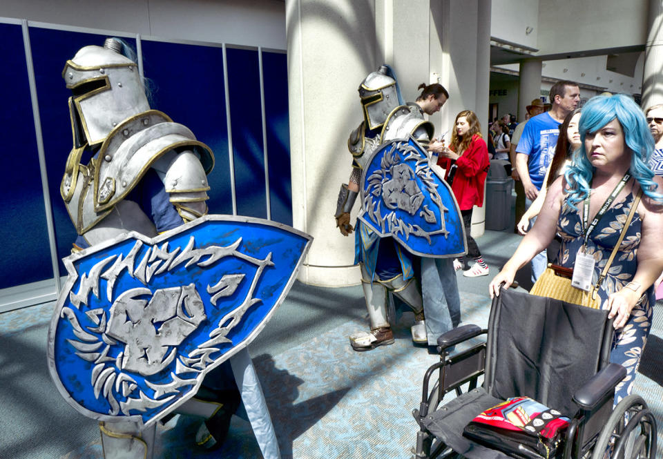 <p>Michael Mijerark and Ryan Trent dress as knights from <em>Warcraft</em> at Comic-Con International on July 19, 2018, in San Diego. (Photo: Richard Vogel/AP) </p>