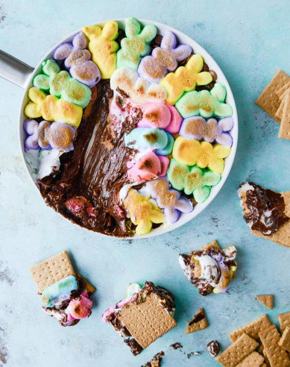 Peeps add color and marshmallow meltiness to this skillet of chocolate-peanut butters'mores dip.