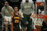 Atlanta Hawks' John Collins makes a three-point basket during the second half of Game 2 of the NBA Eastern Conference basketball finals game against the Milwaukee Bucks Friday, June 25, 2021, in Milwaukee. (AP Photo/Morry Gash)