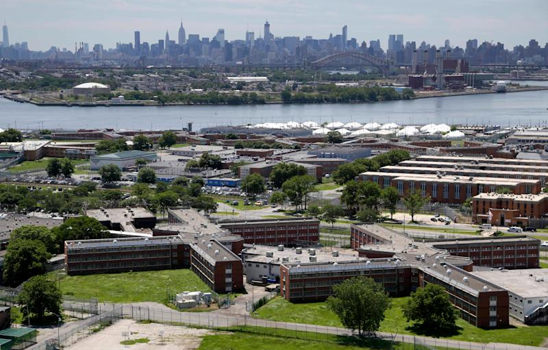 This June 20, 2014, file photo shows the Rikers Island jail complex with the Manhattan skyline in the background. (Photo: Seth Wenig/AP)