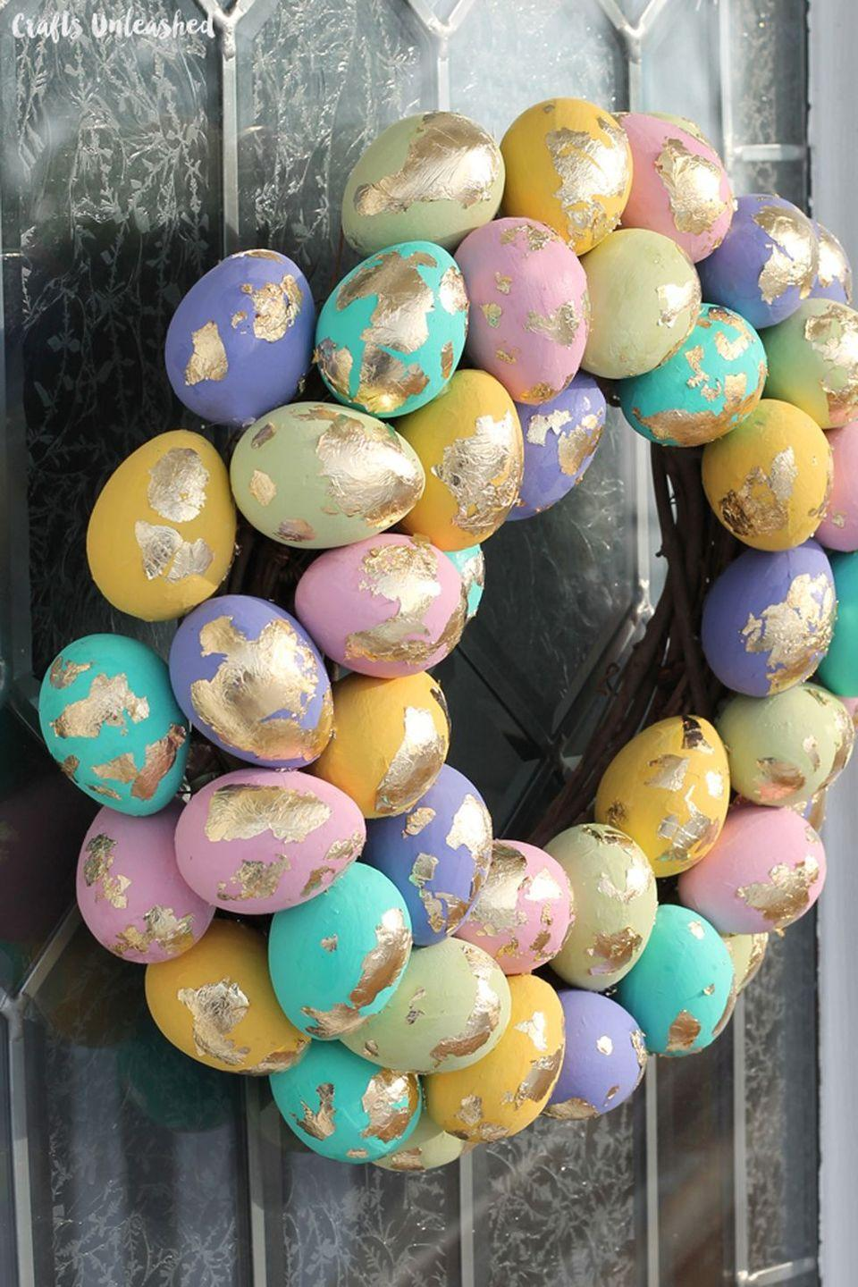 """<p>This fun project utilizes one of our favorite crafting supplies: gold leaf! The result is a decidedly dazzling Easter wreath.</p><p><strong>Get the tutorial at <a href=""""http://blog.consumercrafts.com/seasonal/spring/easter-decorations-seasonal/speckled-egg-diy-easter-wreath/"""" rel=""""nofollow noopener"""" target=""""_blank"""" data-ylk=""""slk:Crafts Unleashed"""" class=""""link rapid-noclick-resp"""">Crafts Unleashed</a></strong><strong>.</strong></p><p><a class=""""link rapid-noclick-resp"""" href=""""https://www.amazon.com/Gigules-Imitation-Painting-Crafting-Decoration/dp/B07CQD174T?tag=syn-yahoo-20&ascsubtag=%5Bartid%7C10050.g.4088%5Bsrc%7Cyahoo-us"""" rel=""""nofollow noopener"""" target=""""_blank"""" data-ylk=""""slk:SHOP GOLD LEAF"""">SHOP GOLD LEAF </a></p>"""