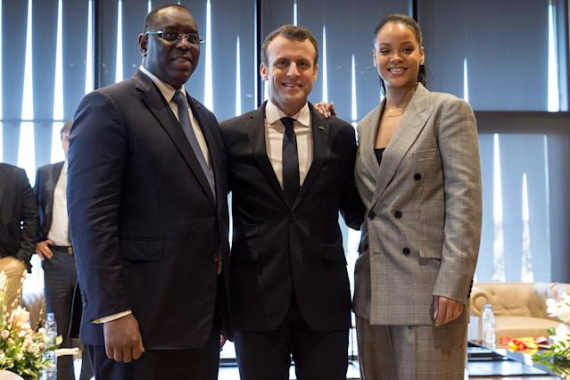 "L-R, Senegalese President Macky Sall, French President Emmanuel Macron and singer Rihanna pose as they attend the conference ""GPE Financing Conference, an Investment in the Future"" organised by the Global Partnership for Education in Dakar, Senegal, February 2, 2018. REUTERS/Jean-Claude Coutausse/Pool"