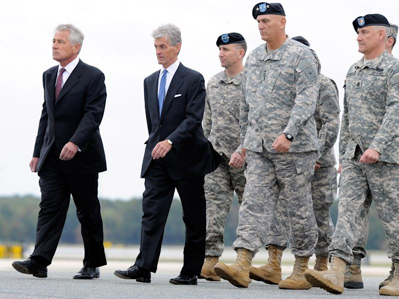 From left, Defense Secretary Chuck Hagel, Army Secretary John McHugh, Army Lt. Gen. Robert B. Abrams, Army Chief of Staff Gen. Raymond T. Odierno and other officials walk on the airfield at Dover Air Force Base, Del. before watching the remains of Pfc. Cody J. Patterson, not pictured, get carried off a military plane Wednesday, Oct. 9, 2013. According to the Department of Defense, Patterson, 24, of Philomath, Ore., died Oct. 6, 2013 in Zhari district, Afghanistan of injuries sustained when enemy forces attacked his unit with an improvised explosive device. (AP Photo/Steve Ruark)