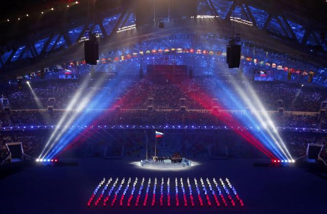 The Russian flag is being raised during the opening ceremony of the 2014 Sochi Winter Olympics, February 7, 2014. REUTERS/David Gray (RUSSIA - Tags: OLYMPICS SPORT)