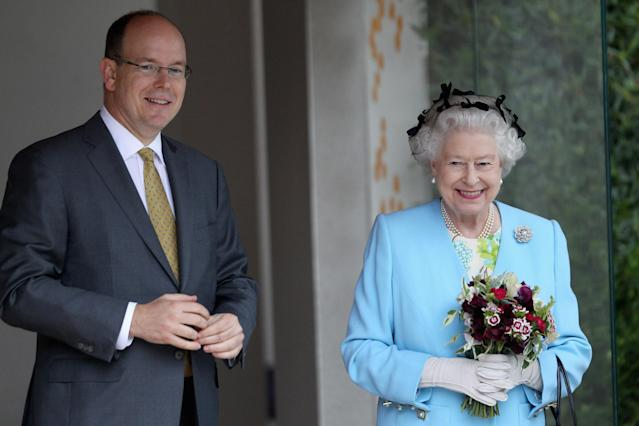 Prince Albert II of Monaco shared an update on his coronavirus diagnosis. Depicted in 2011 with Queen Elizabeth. (Photo: REUTERS/Chris Jackson/Pool)