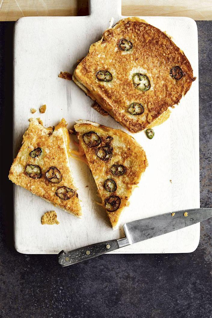 """<p>Courtesy of Chrissy Teigen, this grilled cheese is as indulgent as a classic grilled cheese, but with a twist.</p><p><strong><em>Get the recipe at <a href=""""https://www.goodhousekeeping.com/food-recipes/a25890925/chrissy-teigen-jalapeno-parmesan-crusted-grilled-cheese-recipe/"""" rel=""""nofollow noopener"""" target=""""_blank"""" data-ylk=""""slk:Good Housekeeping"""" class=""""link rapid-noclick-resp"""">Good Housekeeping</a>. </em></strong></p>"""