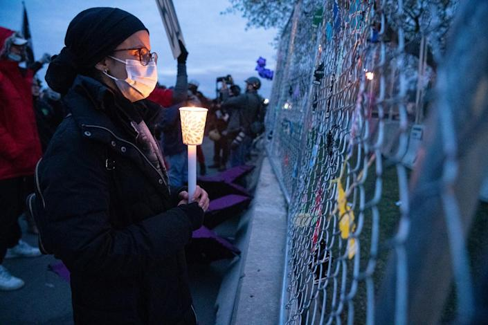 A protester holds a candle